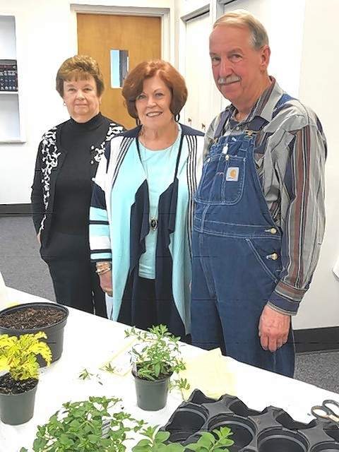 Pictured with Mike Gwaltney, right, are club members Wanda Brown (left) and Donna Barton (center).