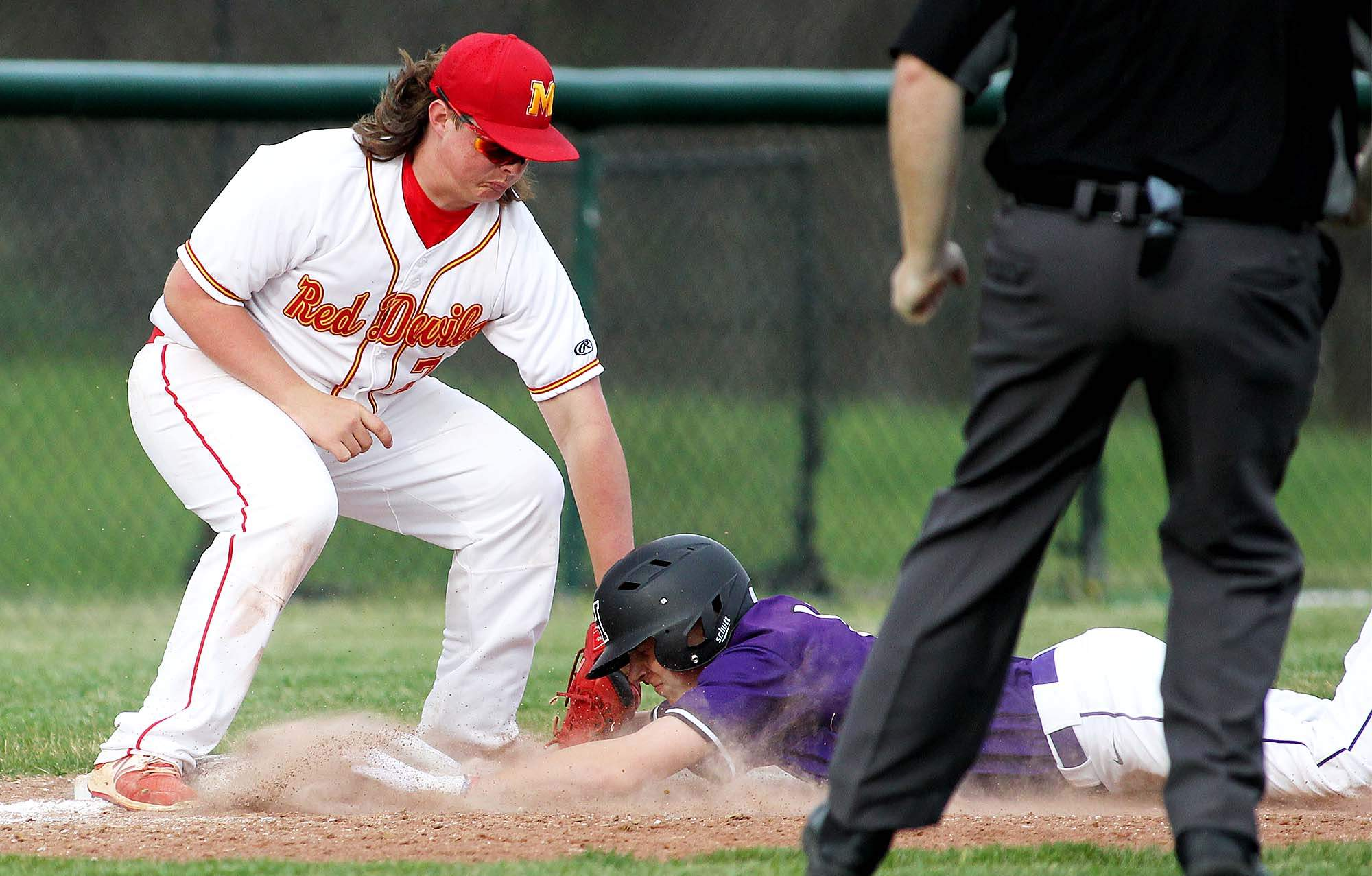 Harrisburg's Javie Beal slides into third base in the top of the fourth inning against Murphhysboro Monday. Beal and the Bulldogs posted a 12-0 win as Beal went 1-for-3 with an RBI.