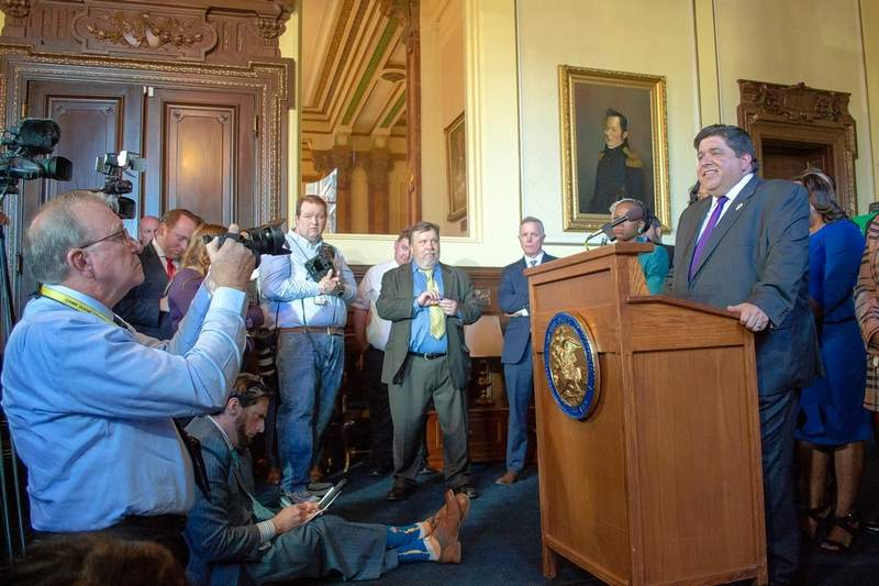 "Gov. J.B. Pritzker faces reporters Tuesday after releasing language for a graduated income tax constitutional amendment during a news conference in his office in Springfield. Pritzker said of the tax proposal, ""It's time to let the people of Illinois -- our taxpayers -- decide."""