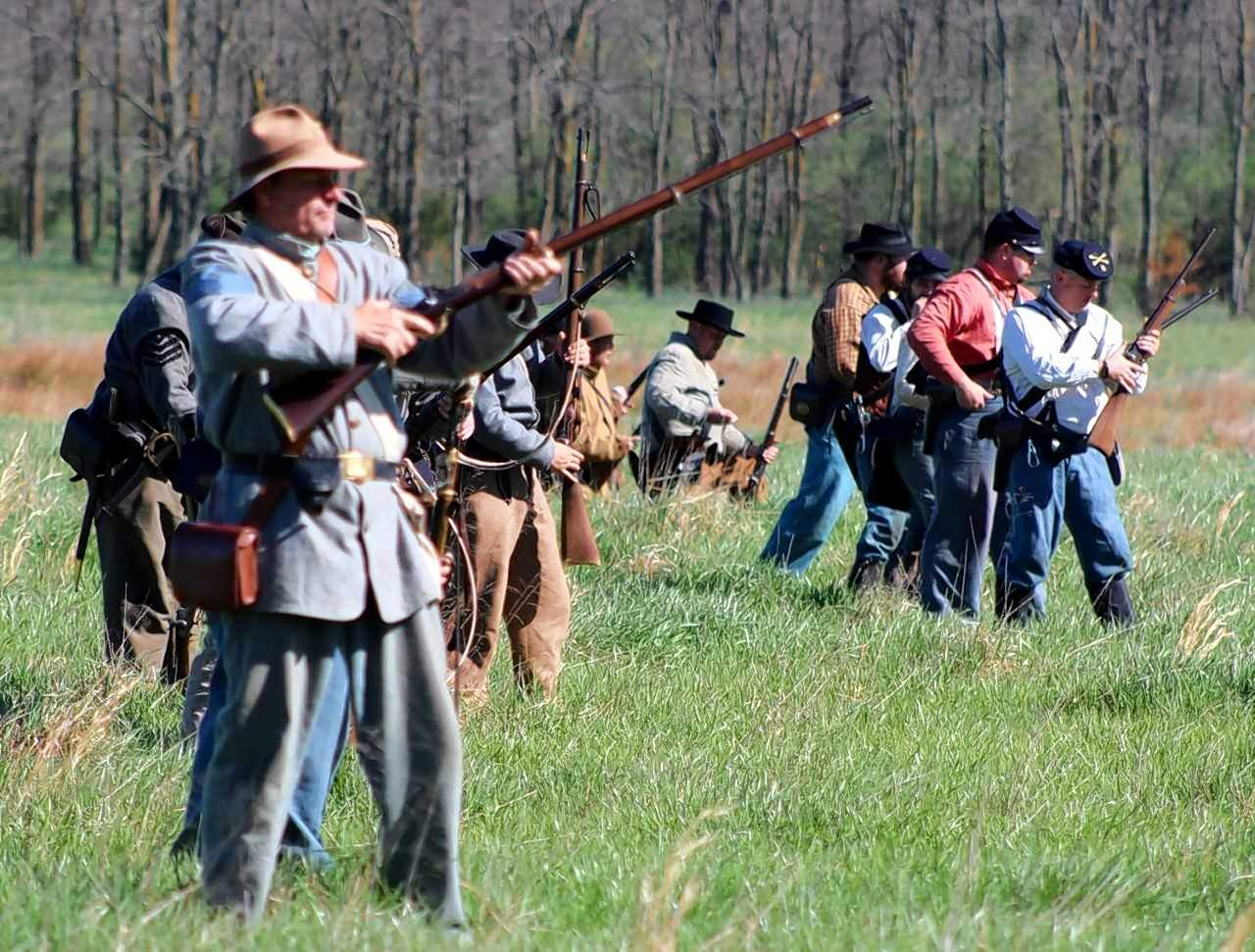 Confederate soldiers on foot engage in the battle.
