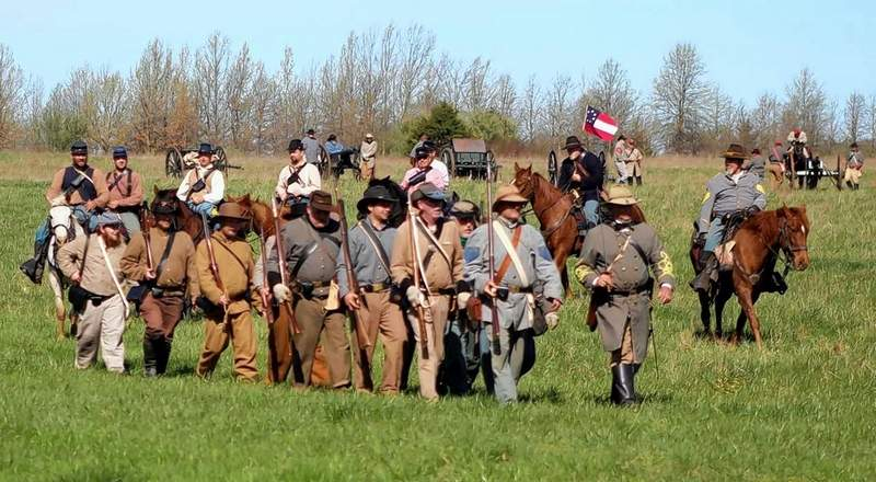 The Confederate Brigade exits the battlefield after the reenactment.
