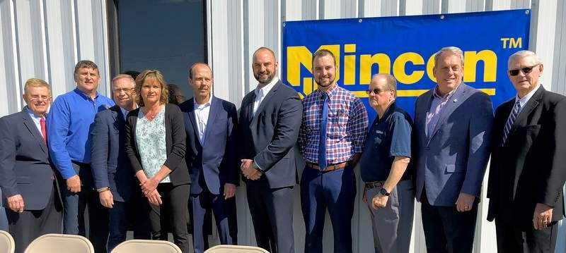 Officials gathered in Benton Tuesday morning for the official announcement that Mincon has purchased the former Bombardier property in the city's industrial park.