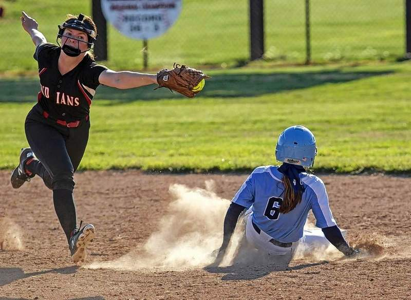 Du Quoin's Katie Smith holds on to a wide throw as Pinckneyville's Taylor Kurtz slides into second base.