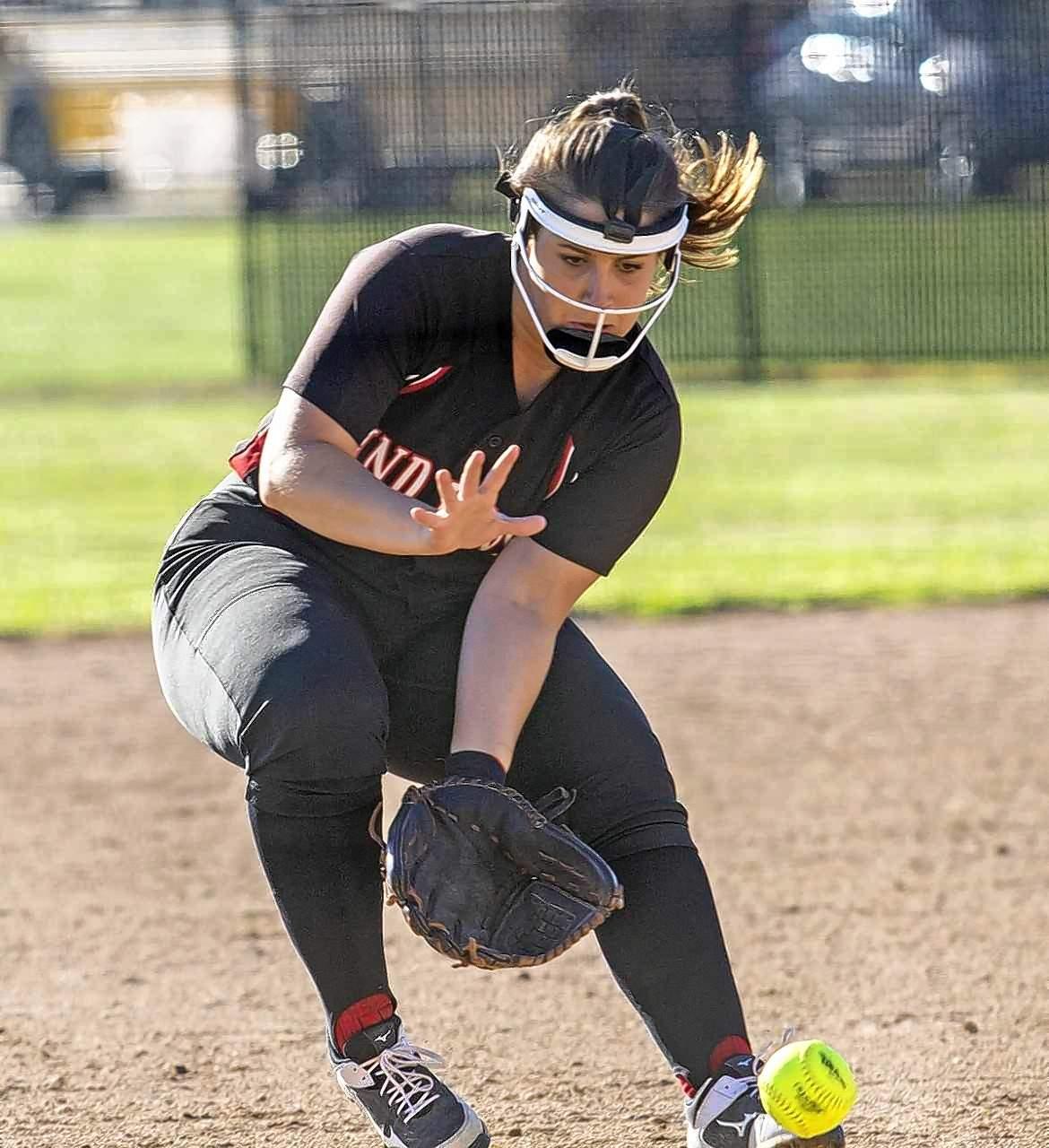 Lady Indians third baseman Morgan Bullar snags a grounder in Monday's game.
