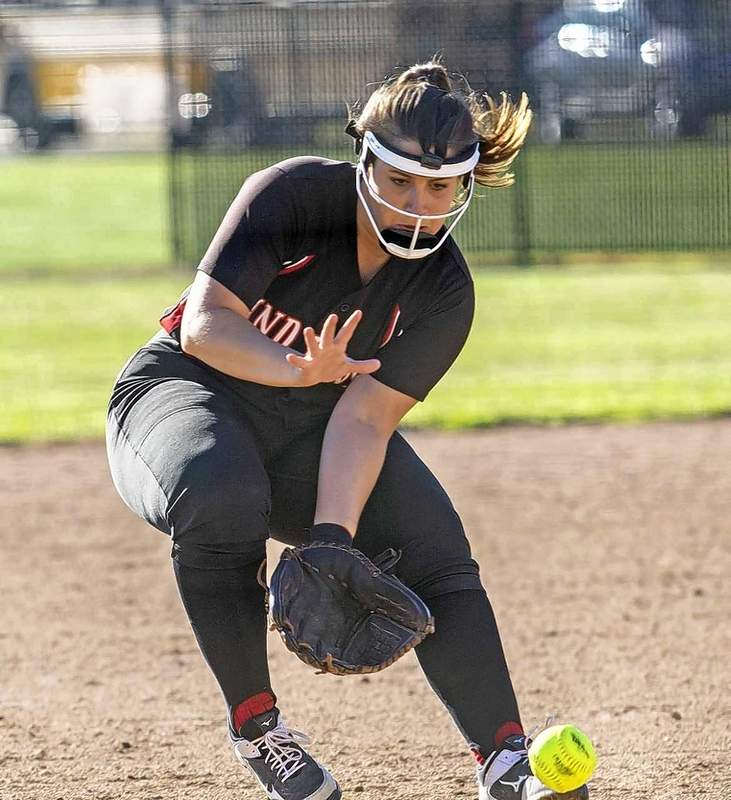 Lady Indians third baseman Morgan Bullar snags a grounder in Monday's game.