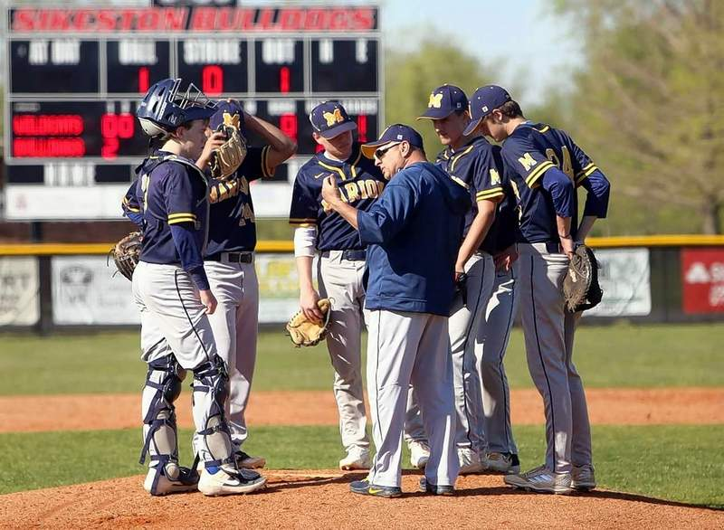 MHS head baseball coach Marty Manfredo pays a visit to the pitching mound to discuss game strategy Monday in Sikeston.