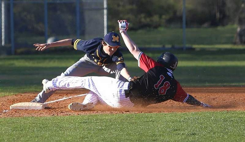 Marion's Mason Gooch tags out Sikeston's Noah Hicks at third base in the sixth inning.