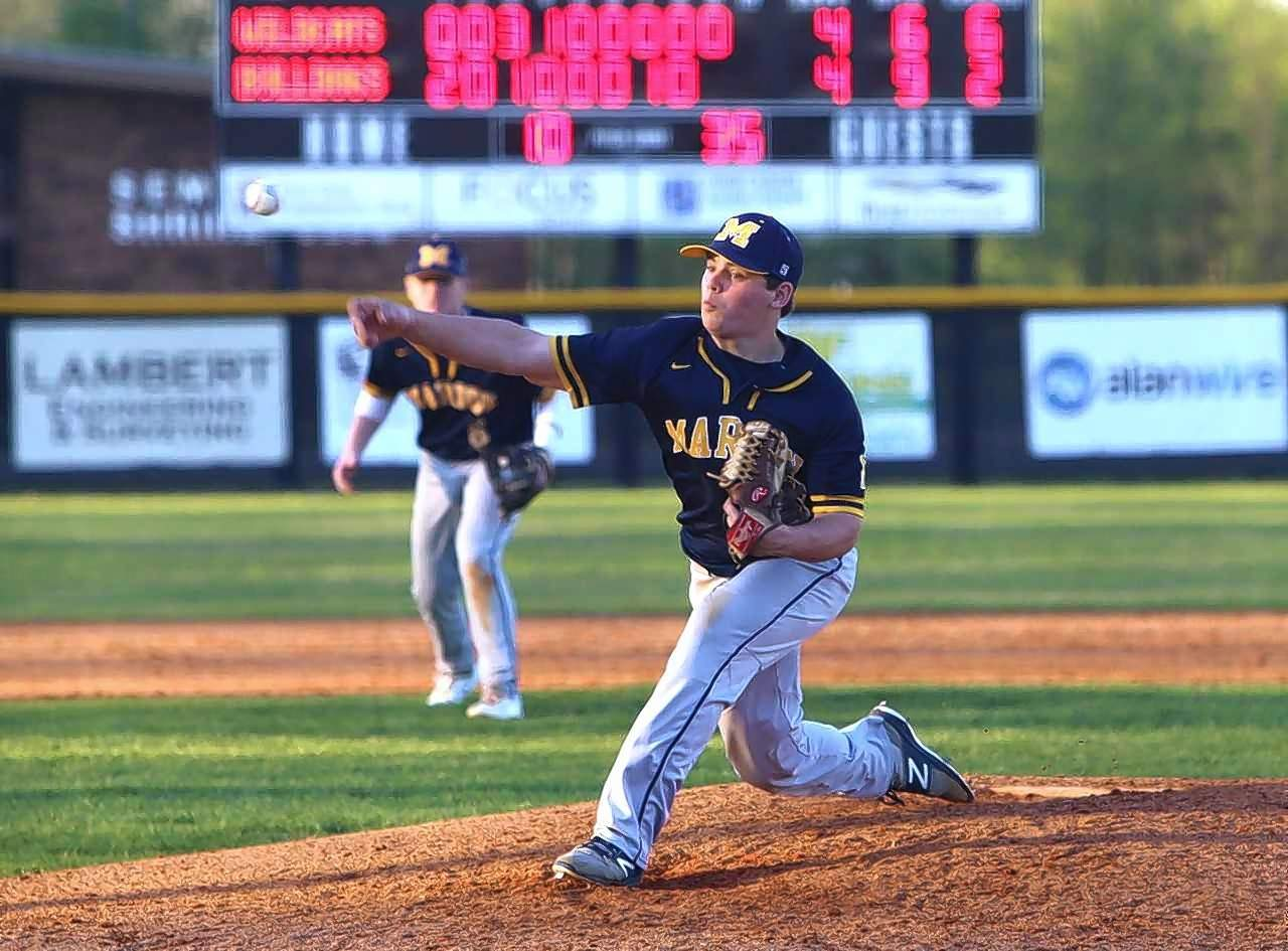Marion's Jake Welch throws a pitch in the ninth inning.