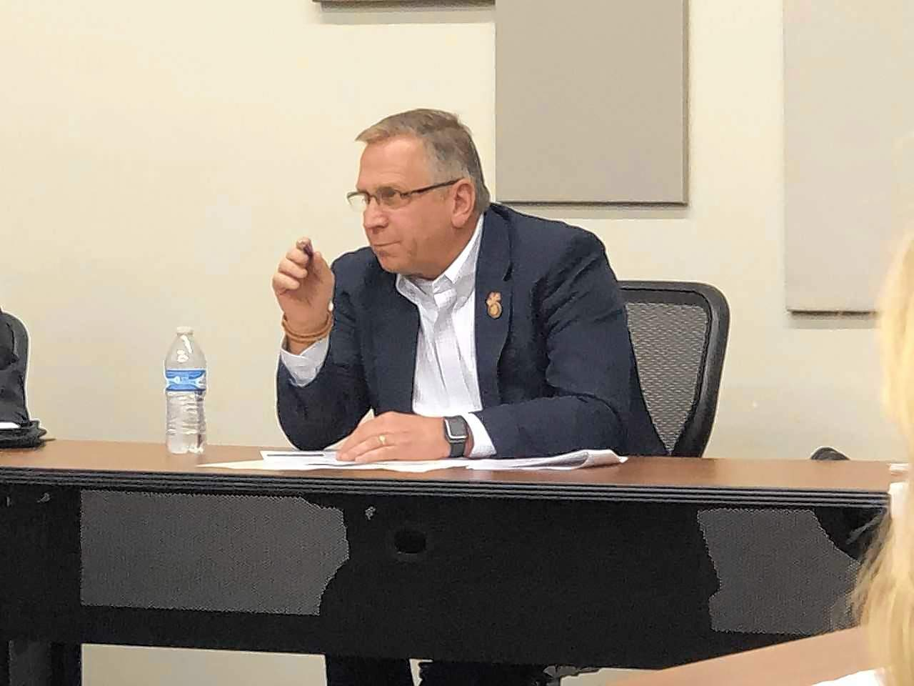 Congressman Mike Bost (R-Murphysboro) listens as IDOT engineer Carrie Nelson explains ongoing infrastructure projects to area leaders during a meeting with the Greater Egypt Regional Planning and Development Commission in Marion on Tuesday.