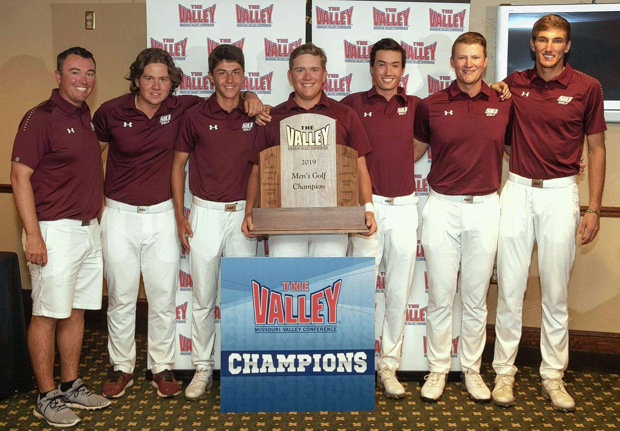 The SIU Men's Golf team captured the Missouri Valley Conference championship in tournament play Tuesday. Pictured from left: Coach Justin Fetcho, Vikar Jonasson, Matthis Besard, Peyton Wilhoit, Frankie Thomas, Luke Gannon, Hunter York.