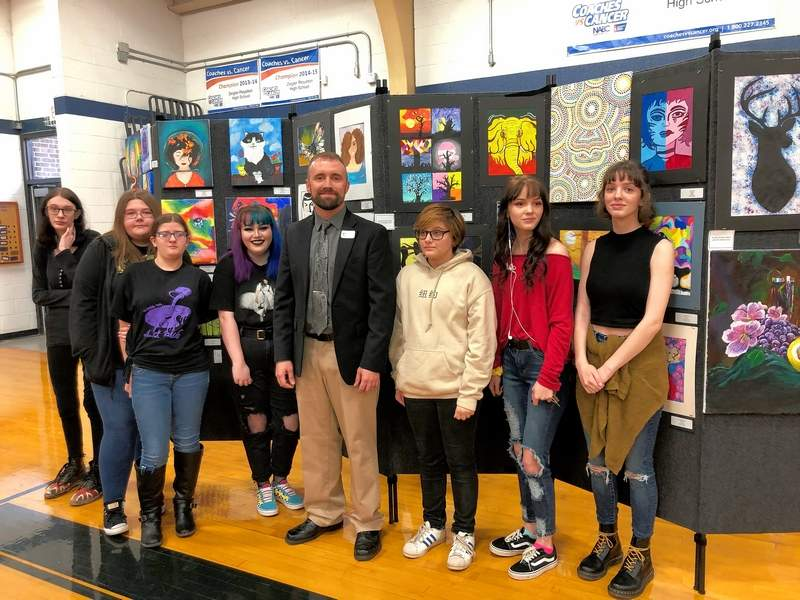 Zeigler-Royalton art teacher Michael Berry, center, stands with students from his school and Sesser- Valier at the inaugural Franklin County High School Art Show held Saturday evening at ZRHS.