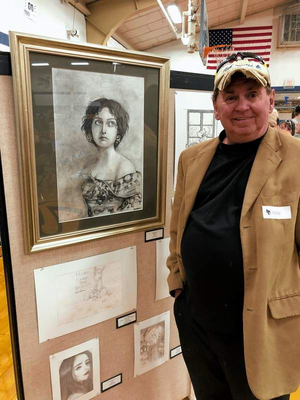 West Frankfort High School art teacher Tim Murphy was all smiles as he looked at the various works done by Franklin County art students at the inaugural Franklin County High School Art Show held at Zeigler-Royalton High School Saturday evening.
