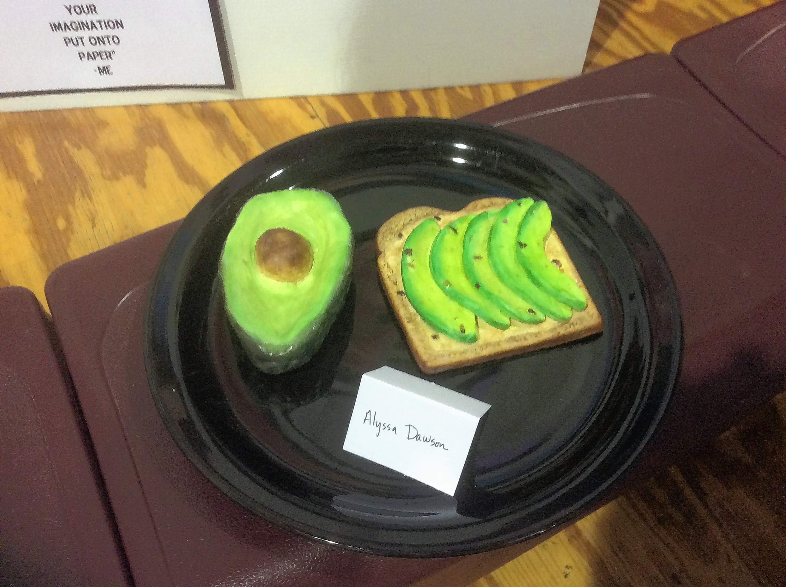 'Outstanding' artist Alyssa Dawson displays a ceramic replica of the wildly popular breakfast food 'Avocado Toast' at the K-8 Art Show April 23 in the Benton Middle School Gym and Commons.