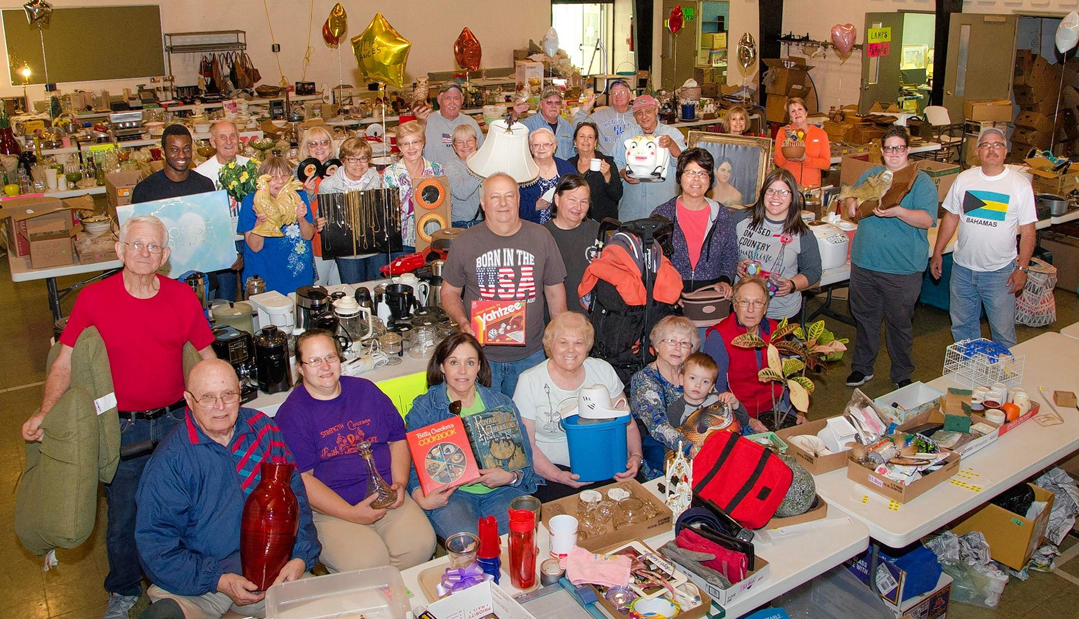 Members of St. Joseph's Catholic Church sort and organize donations for the 13th-annual flea market coming up this Saturday.