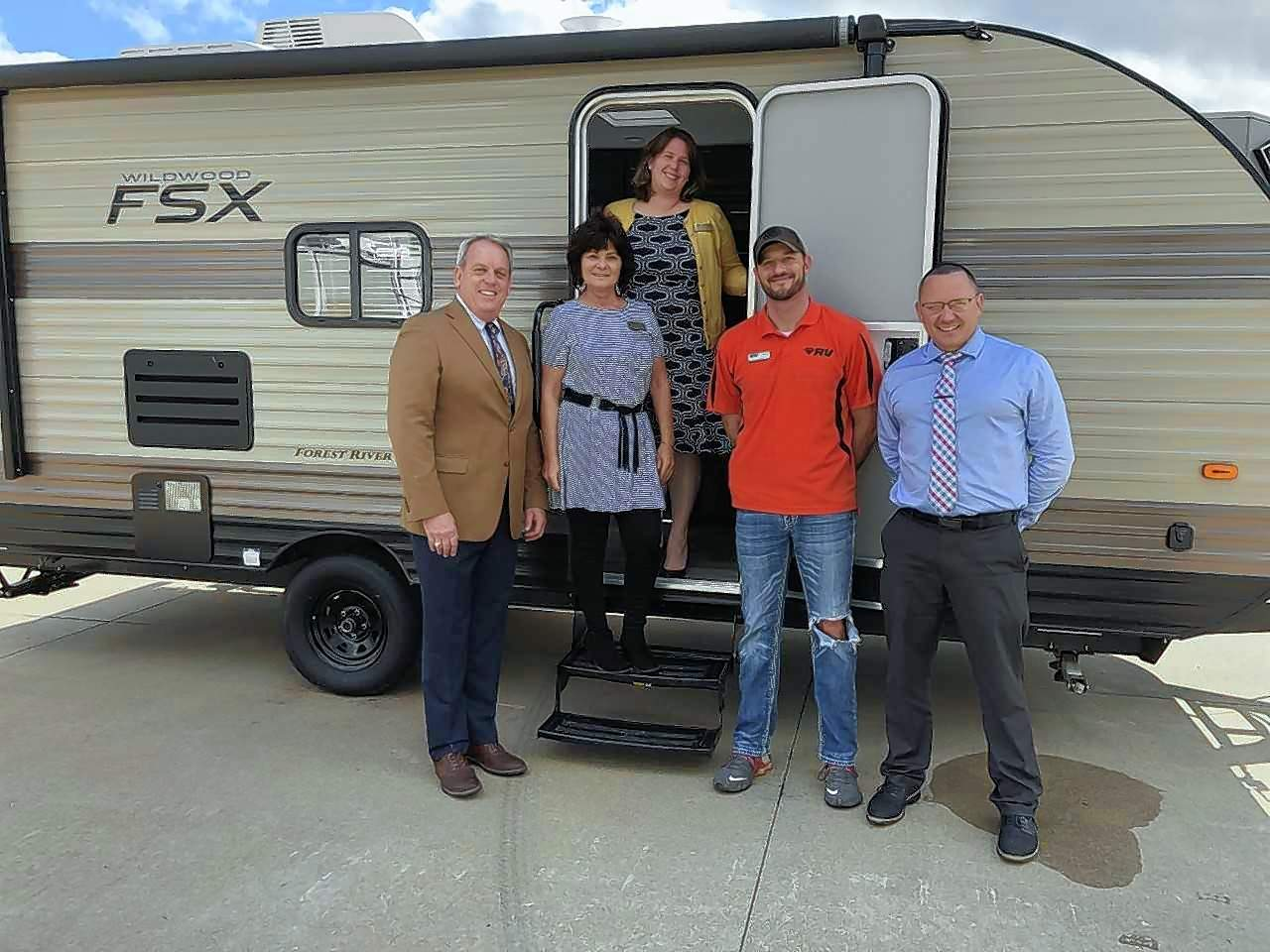 From left, Dale Fowler, Gail Barger, Karen Mullins, Jake Rushing, and Jason Powell gather for a photo of the camper donated by Black Diamond RV to be raffled as part of the SI Made Expo to benefit Honor Flight 006.