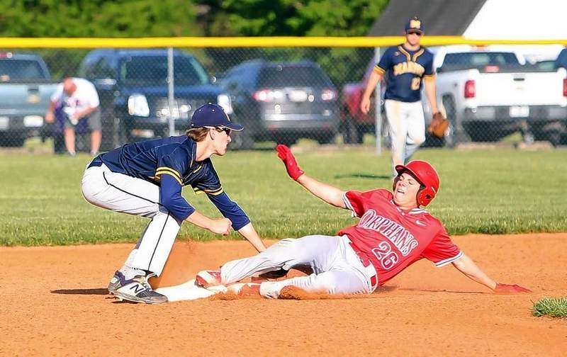 Marion infielder Cavan Cameron applies the tag in game action Tuesday with Centralia.