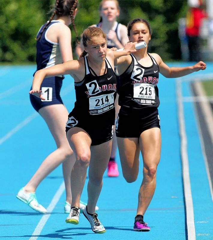 Du Quoin's Gabby Alongi takes the handoff from her sister, Grace, during the 4x800 meter relay race at Thursday's IHSA Class 1A State Track & Field preliminaries on the campus of Eastern Illinois University in Charleston.