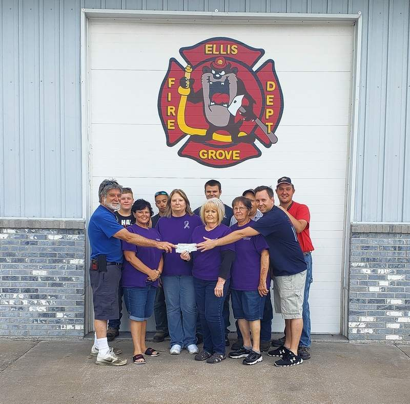 Firefighters present the check to members of the Relay For Life team.