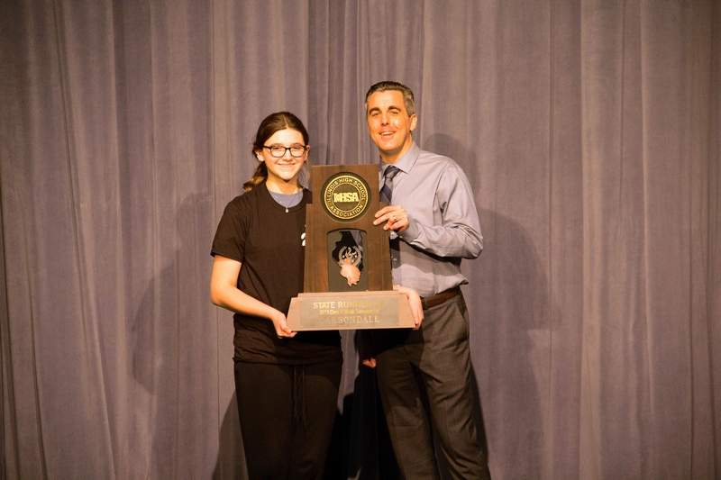 Adelaide Garvey is a freshman clarinetist who earned a Best of Day award for her solo at IHSA solo and ensemble. Principal Ryan Thomas is presenting the trophy.