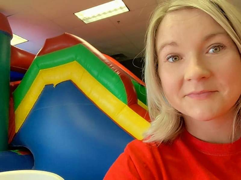 Lara Shaw, left, owner of Southern Illinois Inflatables stands in front of one of their many massive rentable inflatables.