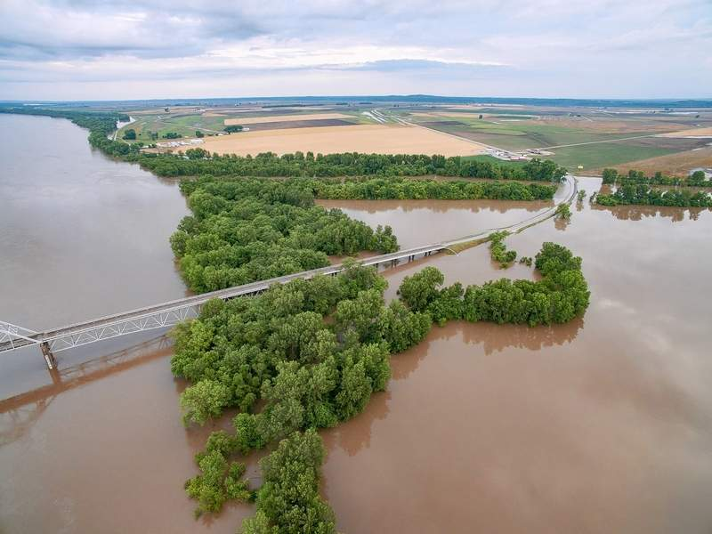 The Chester bridge and Highway 51 disappear into the water as the roadway approaches McBride, Missouri.