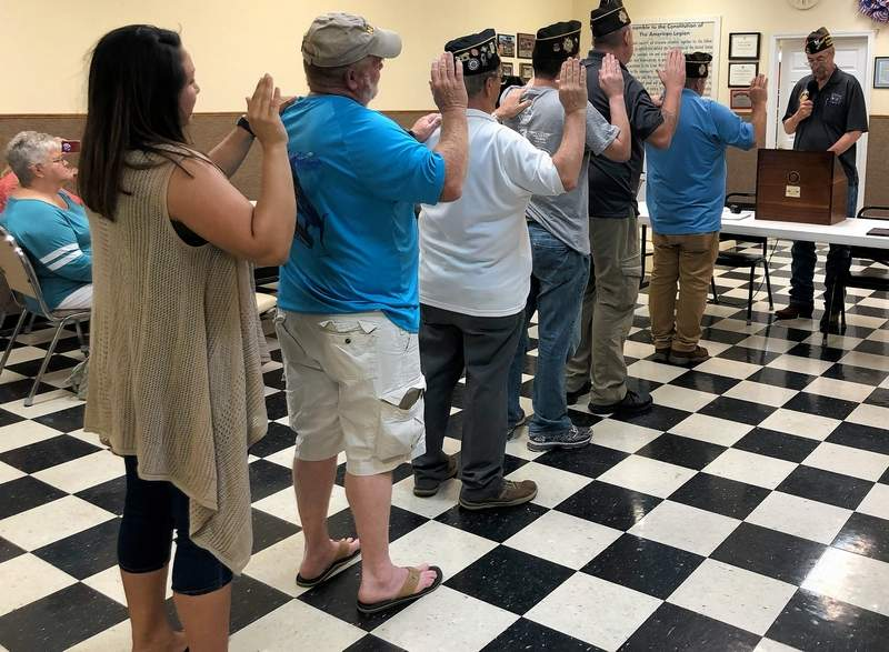 From left, Krystyna Taft, Ron Rose, John Metzger, Nayt Stewart, Mike Cross and Gary Fravel are sworn in as new officers in the Benton VFW Post by Commander Clarence Caraker.