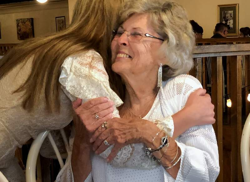 Tara Kay Tanner greets Karen Sala with a hug during a dinner gathering at Bennie's on Saturday, just hours before Sala was inducted into the Miss Illinois Hall of Fame.