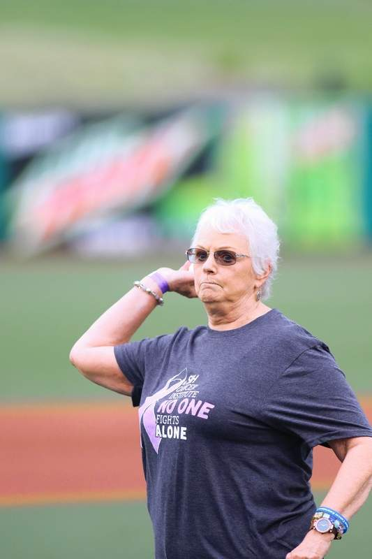 Glenda McDaniel of Carterville prepares to make her first pitch before Friday's SI Miners game. McDaniel is a cancer survivor.