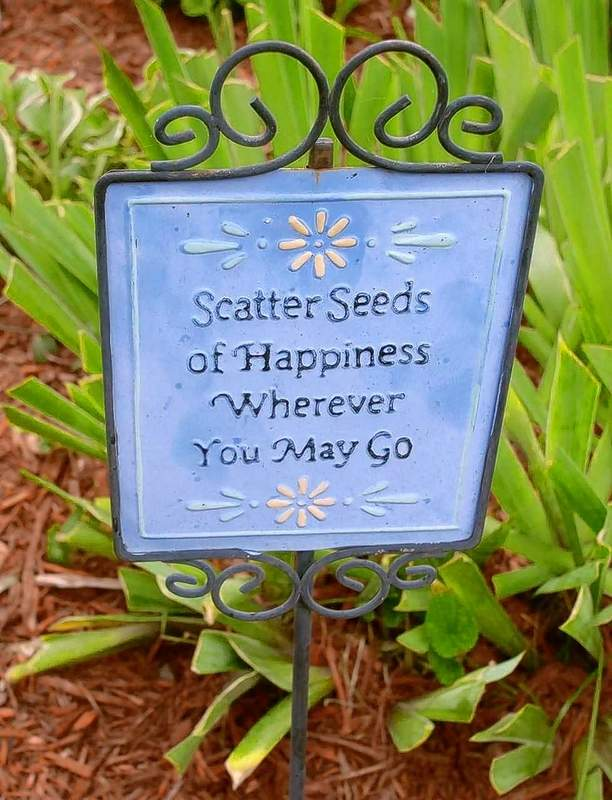 A sign in the yard of Marion gardener Barbara Kigin, whose home was among those on this year's summer garden tour sponsored by the Marion Garden Club.