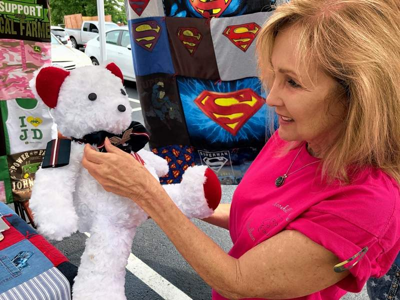 Diane Hill with her own memory bear she created from her flight attendant's uniform.