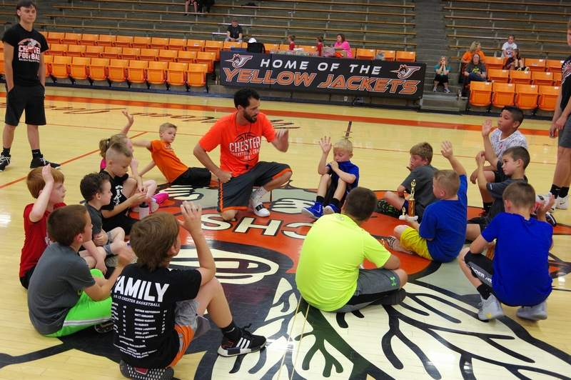 Brad Norman, Chester High School boys basketball coach, talks to members of the 2019 summer basketball camp.