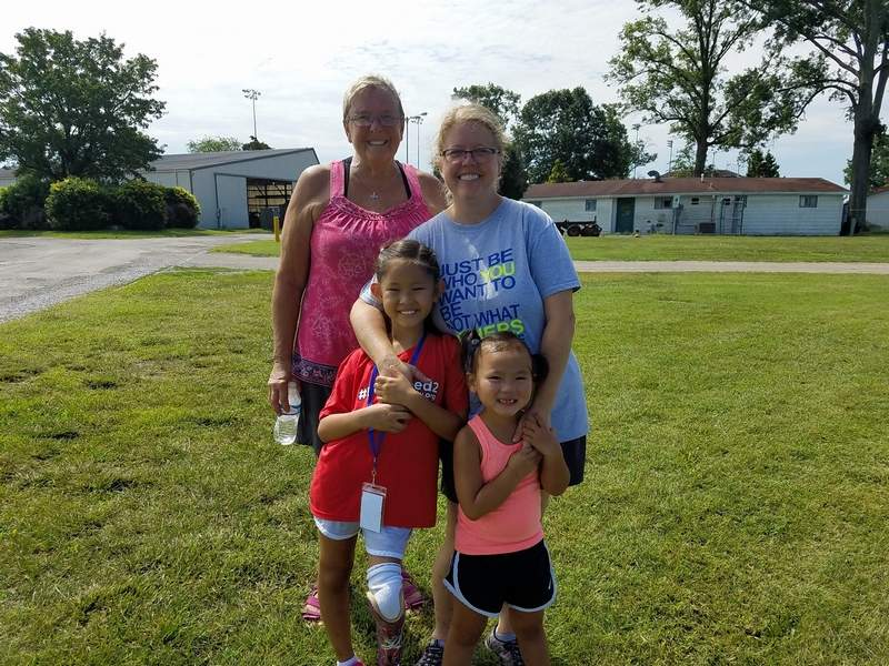 Anna Grace Philippe, 7 (left), is shown here with her younger sister, Elena, 5, mother, Wynne, and grandmother, Lanee. The two children were busy fishing Thursday morning.