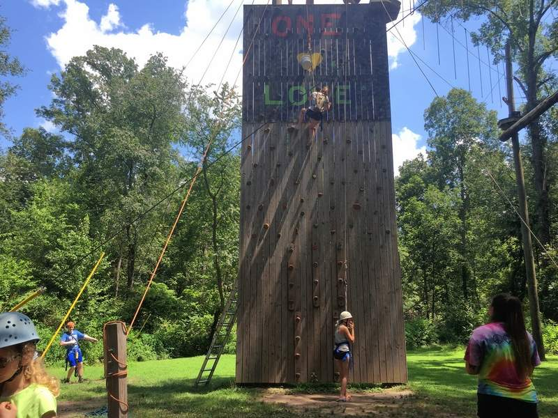 Campers paint the rock wall on their free day.