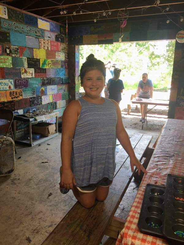 Sydney Fowler poses in the Art and Craft Hut at Camp Manitowa.