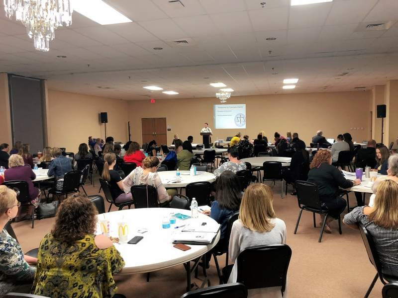 Local officials listen as Matt Buckman, Clinical Director, Child & Adolescent Division for the Egyptian Public & Mental Health Department addresses the ongoing opioid crisis last during last Thursday's conference.