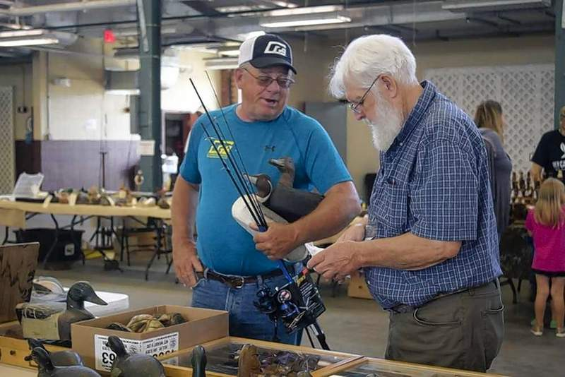 Mark Mitchell of Ashley purchased decoys from lifelong collector, Larry Bartar, of Marion, at the Southern Illinois Sportsmans Show Saturday at the Du Quoin State Fairgrounds. Bartar says most of his collection is for show and trade.