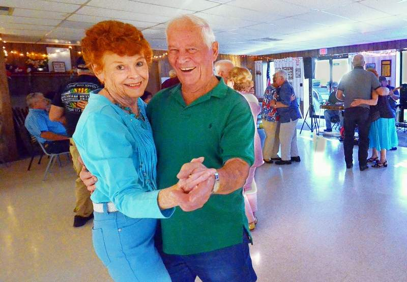 Donna McCowen of Christopher and Richard Phillips of Benton glide across the dance floor at the Gwen Wynn Senior Center in Benton, where couples and individuals gather on Tuesday and Thursday nights to dance to country and popular dance tunes.