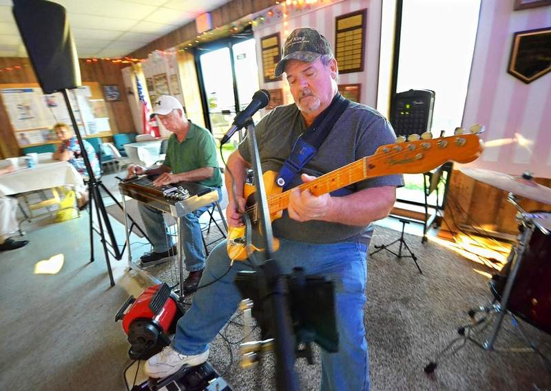 The band Encore, featuring Joey DeNeal, above, on lead guitar and Larry Nolan, left, on steel guitar, can usually be found providing the dance music each Tuesday evening at the Gwen Wynn Senior Center in Benton.