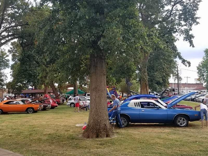 Scott Vaughn, owner of Du Quoin Auto Service, held a car show Friday evening, raising nearly $500 for the Du Quoin Shop with a Cop program.