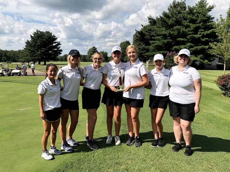 Members of the Harrisburg girls' golf team pose with their second place trophy from the Mt. Carmel Invitational late last week.