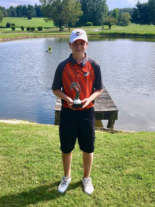 Jarrett James, with the second place trophy for the tournament.