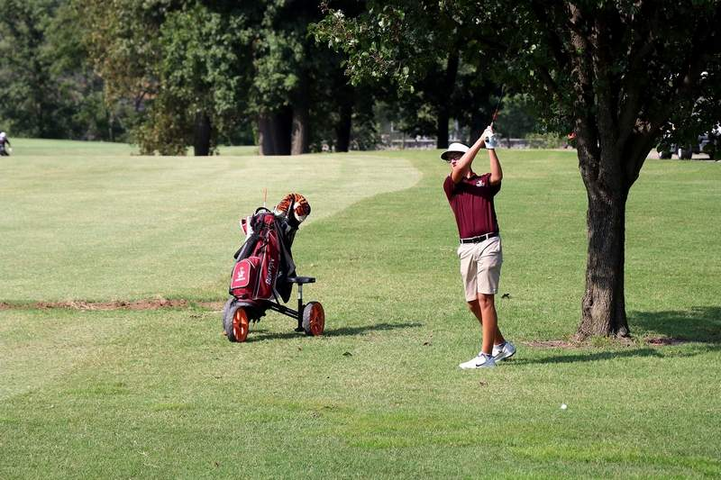 Benton golfer Cy Norman plays this iron shot Monday at Benton Country Club.
