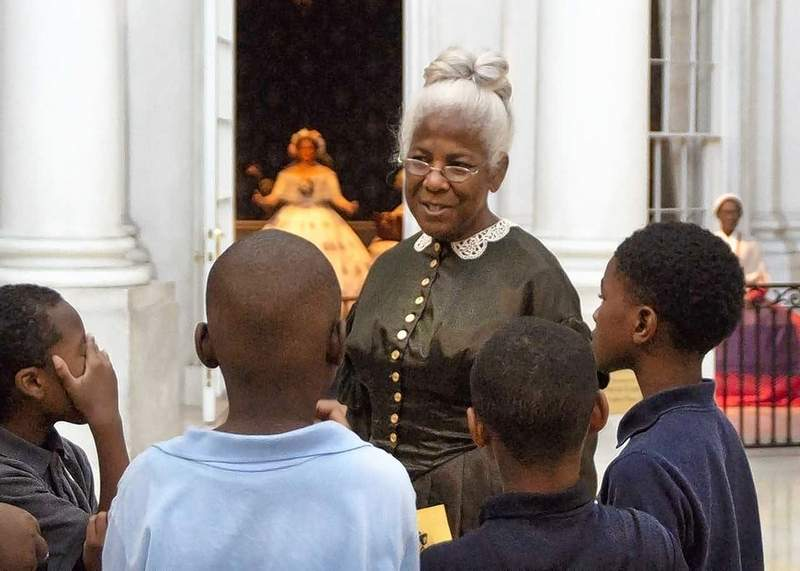 A re-enactor visits with students during a recent field trip to the Abraham Lincoln Presidential Library and Museum in Springfield.