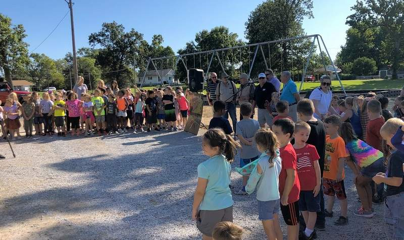 First and second grade students from Jefferson School are among more than 200 guests who dedicated the Mike Dean Memorial Playground and Park in Johnston City on Wednesday.