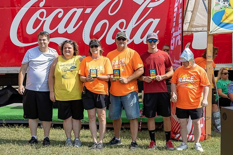 Volunteers receiving plaques for all they have done for the Duck Derby Dash event are Carolyn Kowalik, Alan Kremer, and Drake Kremer.