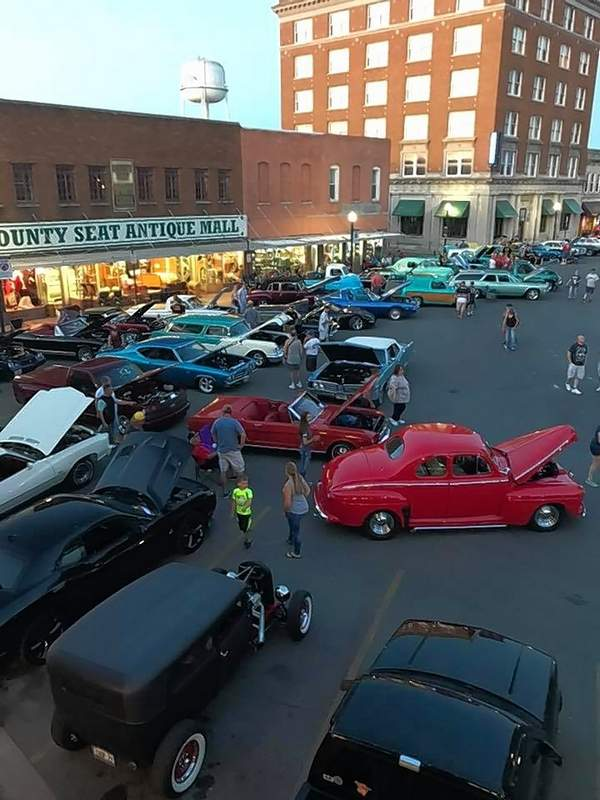 A view of the crowd and cars at the Rend Lake Car Show from the balcony of Edwards Antiques.
