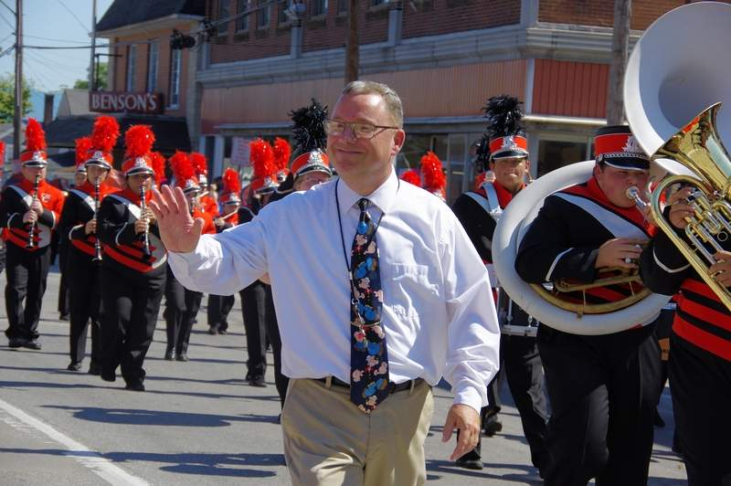 """Chester High School Band Director Steve Colonel walks alongside his band as they play songs from their 2019 field show, """"The Music of Queen."""""""