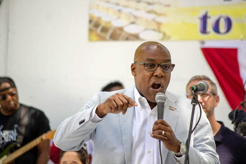 Attorney General Kwame Raoul speaks during the Governor's Day Picnic on the Director's Lawn at the  Illinois State Fair on Aug. 14 in Springfield.