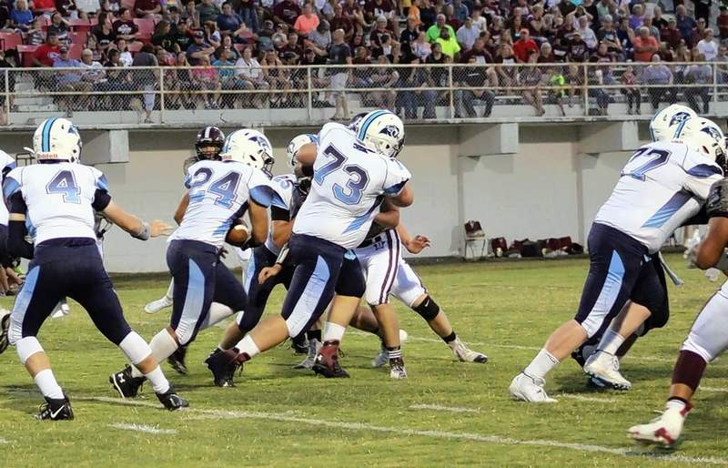 Panthers running back Darian Harris (24) takes the handoff from quarterback Lucas Teel (4) and hits the hole opened between Ethan Cheek (73) and Dalton Kitchen (77).