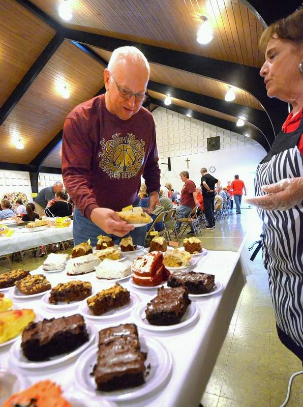 Nick Laur of Sesser sought out advice from volunteer desert hostess Kathy Neal while trying a piece of sugar-free pie at at St. Joseph's Catholic Church in Benton Friday night for their annual Fall Fish Fry.